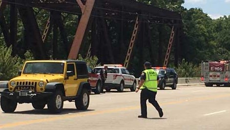 Rescue crews at the Whitewater River on Sunday.