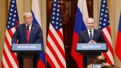 epa06893372 US President Donald J. Trump (L) and Russian