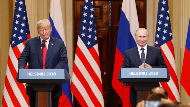 President Donald Trump (L) and Russian President Vladimir Putin (R) hold a joint press conference in the Hall of State at Presidential Palace following their summit talks, in Helsinki, Finland, 16 July 2018.