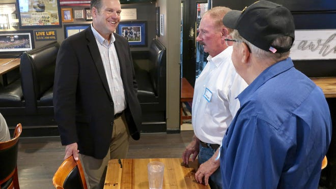 Kris Kobach, left, a Republican candidate for the U.S. Senate in Kansas, speaks with supporters Bill Vonderschmidt, center, and Bob Sines, both from Hiawatha on Wednesday during a meet-and-greet event in Holton. Kobach is locked in a tight race with western Kansas Rep. Roger Marshall for the GOP nomination.