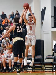 Northeastern's Antonio Rizzuto shoots against Delone