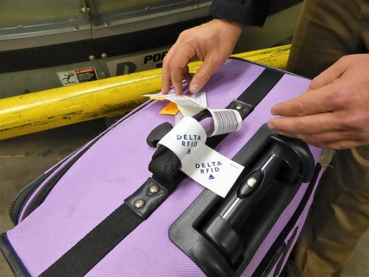 636583649480284857-18-Delta-and-some-other-airlines-add-or-embed-an-RFID-tag-in-addition-to-the-traditional-10-digit-luggage-label..JPG