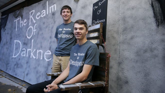 Ben Hurst (front) and Dalton Polomis turned a garage in Kaukauna into the Realm of Darkness.