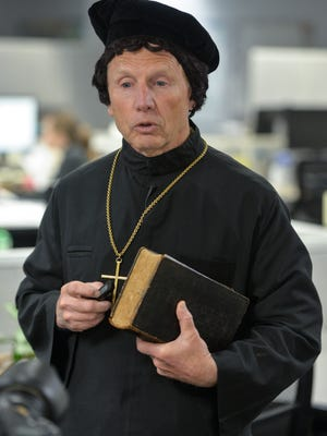 Rev. Larry Strenge speaks in character as Martin Luther following an interview Friday, Oct. 27, at the St. Cloud Times offices in St. Cloud. Strenge is the Director for Evangelical Mission for the Southwestern Minnesota Synod, Evangelical Lutheran Church in America.