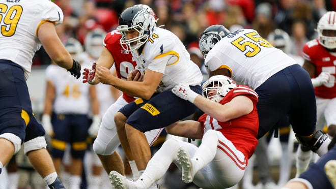 Wisconsin linebacker Noah Burks sacks Kent State quarterback Dustin Crum during the first half of last year's game in Madison, Wis. The Golden Flashes were scheduled to open the 2020 season against Penn State on September 5, but the Big Ten announced on Thursday that its teams will not play non-conference games this fall due to the coronavirus pandemic.