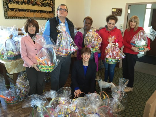With the Easter baskets created by Dunellen kids for children at the Feeding Hands Pantry at the Emmanuel Church in Somerville, Michele Kavanagh, vice president of Unity Bank, Pastor Jerry McLynn, two recipients of the Easter Baskets, Lois Bennett, executive director of the Feeding Hands Pantry Ministry and Connie Stanzione. The Unity Bank was instrumental in the monetary donation to get the baskets made.