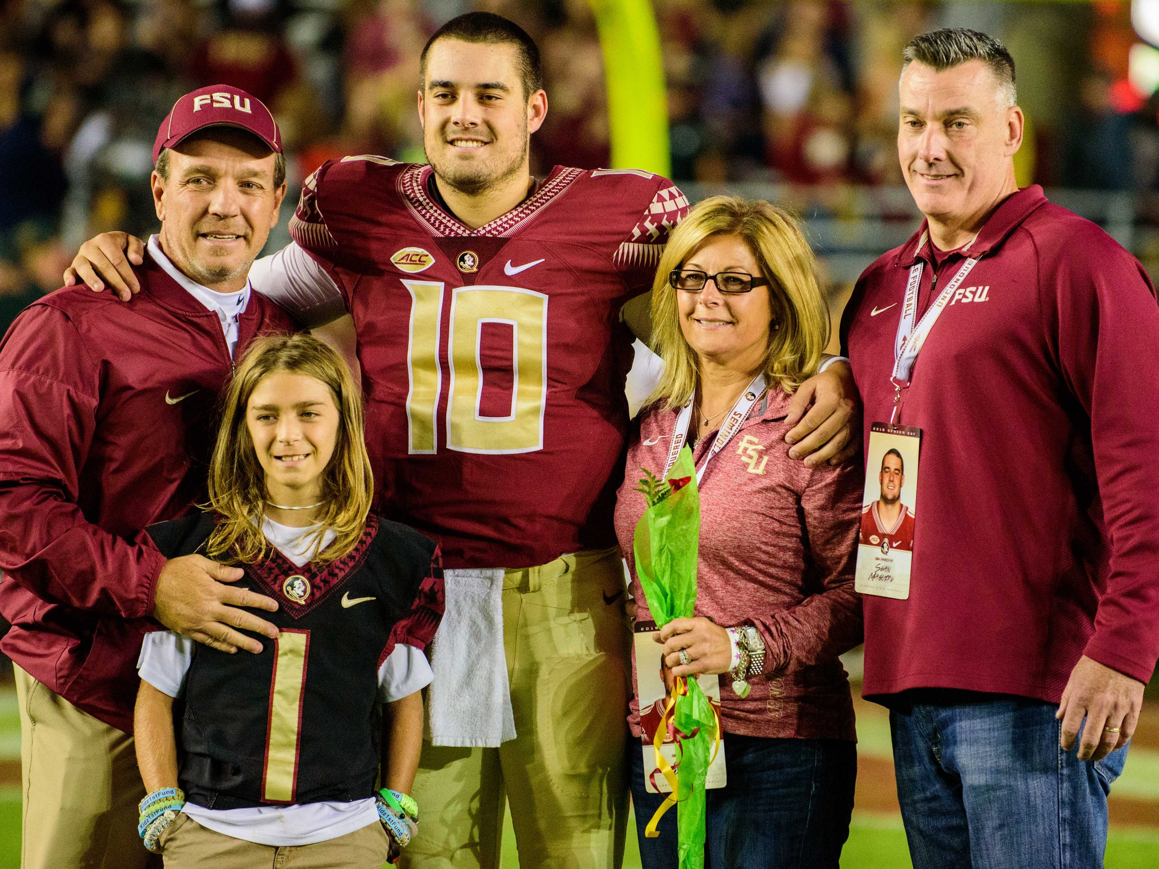 Sean Maguire (10) celebrates Senior Night with his family during the 45-7 Florida State University victory against Boston College on Fri., Nov. 11, 2016 at Doak Campbell Stadium, in Tallahassee, FL.