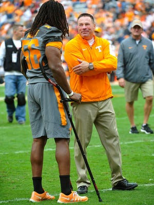 Injured Tennessee linebacker Curt Maggitt (56) talks with Coach Butch Jones before Tennessee played Georgia on Oct. 10, 2015.