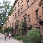 The St. Nicholas Historic District, also known as Striver's Row in the Harlem section of New York. The tree-lined two-block area of West 138th and 139th streets is known for its elegant brick and stone townhouses. Many prominent African-Americans lived on the blocks including musician Eubie Blake and Congressman Adam Clayton Powell Jr.