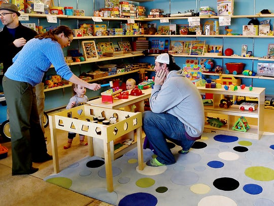 Parents and children browse the Finger Lakes Toy Library