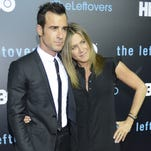 Justin Theroux and Jennifer Aniston arrive at the second season premiere of 'The Leftovers' Saturday, Oct. 3, 2015, in Austin, Texas.