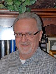Pastor Dan Lewis, a retired college professor, creates