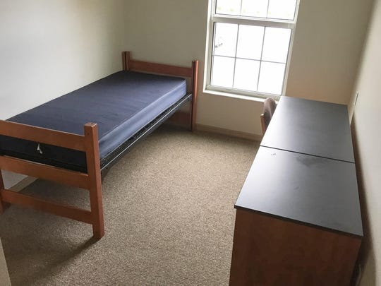 Before Bed Bath & Beyond. The is the room before Cristy Heath with Bed Bath & Beyond, started from scratch and totally redecorated a dorm bedroom and the bathroom at the Harris Village dorm building at Florida Institute of Technology.