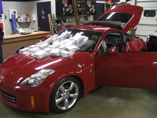 In 2009 Michigan State Police stopped Patrick Austin in Paw Paw towing two sports cars in a trailer. The cars held about $1 million in cash.