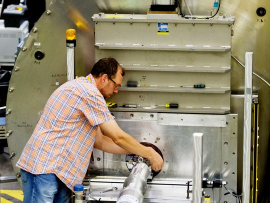 A researcher works in the interior of the cold neutron