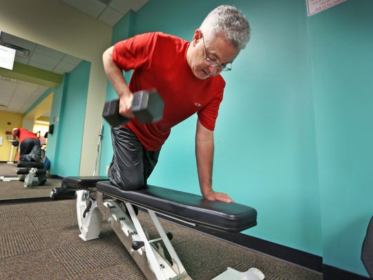 Chris Tuten, vice president of corporate information security at Navient in Fishers, says regular exercise gives him more energy and cuts his stress level, but finding time to work out can be challenging.