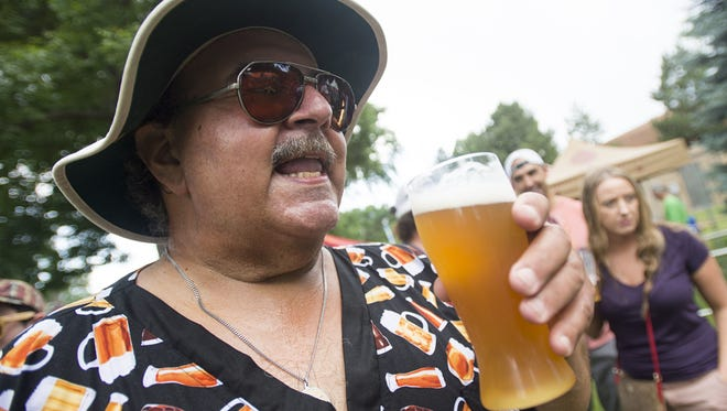 Mike McDonald sips a beer from Odell Brewing. The brewery is hosting Small Batch Festival on Saturday.
