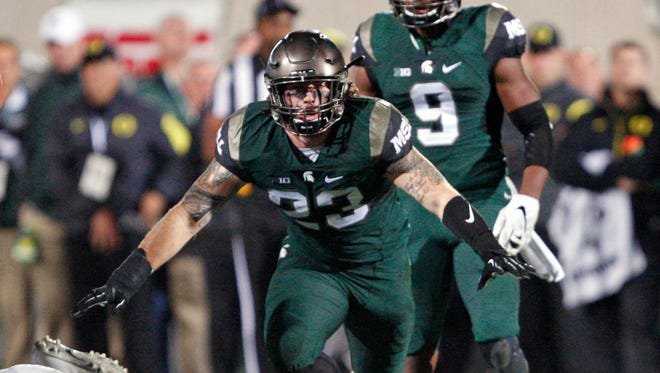 Michigan State linebacker Chris Frey (23) celebrates after making a play during the fourth quarter against the Oregon Ducks at Spartan Stadium.