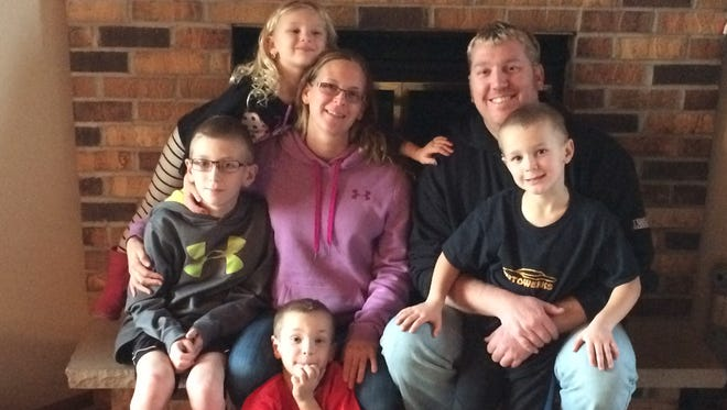 The Wagner family: (front, seated) Isaac, (middle, from left) Aiden, Nicole, Jeremy, Evan and (back) Autumn.