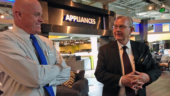 In this May 5, 2016 photo, Alan Hunsacker, left, and David Bauer speak inside the furniture store where they work in Orem, Utah. Many GOP voters in deeply conservative Utah are experiencing an acute version of the political panic attack that's gripped much of the Republican Party since Donald Trump's remaining rivals for the nomination dropped out.