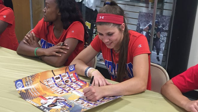 Cameron Onken signs posters for fans after the Indiana All-Stars defeated the junior all-stars 119-67 on Thursday in Lebanon.