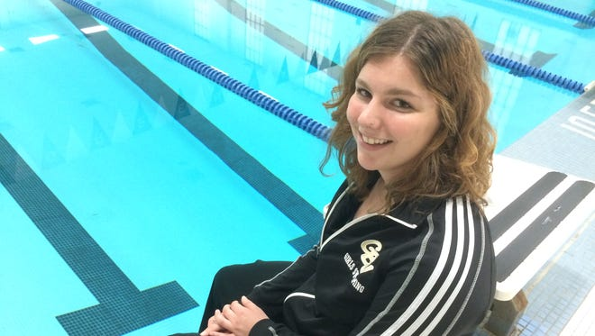 Green Bay Southwest junior Presley Busch is aiming to break a team record in the 500-yard freestyle this season. She is shown holding a necklace she looks at before races to remember her father, Louis, who died in February.