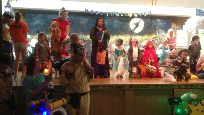 Children line up for the costume contest at the Vero Beach Community Center after a previous Halloween parade.