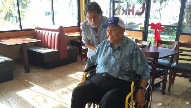 Al Velasquez, left, chats with Ventura Fernandez on Friday. Velasquez organized a fundraiser for Fernandez last month after he got his wheelchair stolen.