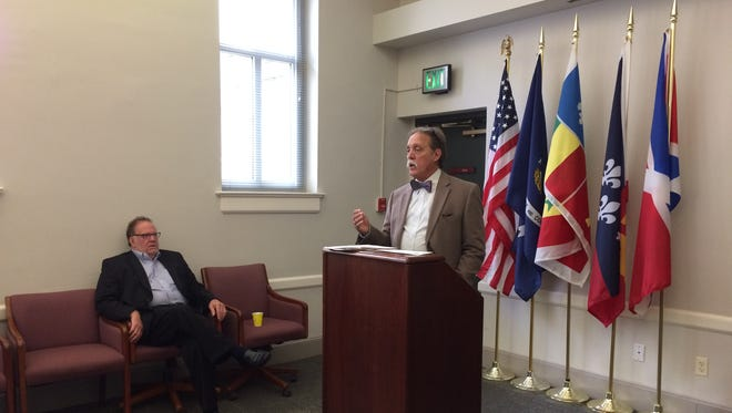 Barry Ancelent, right, founder and board president of Festivals Acadiens et Creoles, speaks at Monday's press conference at Le Centre International with Pat Mould.