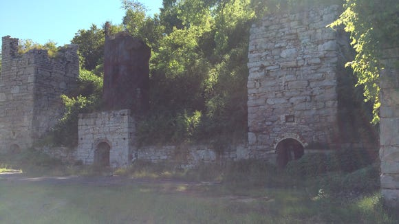 "These lime kiln ruins at High Cliff State Park were run by the Western Lime and Cement Company from 1856 to 1956. Lime quarried at the top of the ledge was dropped into the kilns and ""baked"" to draw out the powder. That ""quick lime"" was used in plaster, cement and put on farm fields."