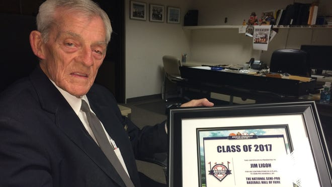Jim Ligon of Henderson shows off his plaque commemorating his induction into the National Semi-Pro Baseball Hall of Fame.