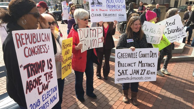 Indivisible SC 4 members protest while Ivanka Trump speaks Friday, Jan. 26, 2018, at the Westin Poinsett Hotel to a group of Greenville area businesswomen.