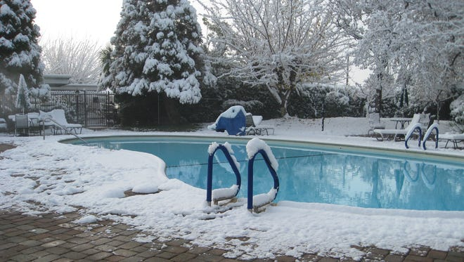 A pool at a Hilltop Drive apartment complex was deserted when snow fell in Redding in 2013.