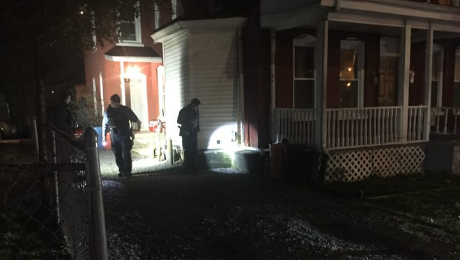 Vineland Police look for evidence after they were dispatched to East Quince Street for reported shots fired Monday evening.
