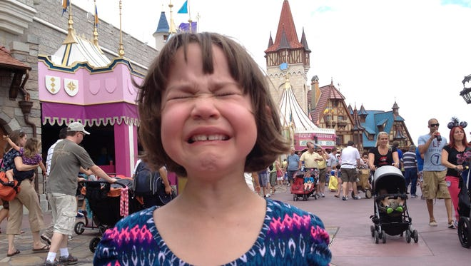 Erysse Elliott at the Magic Kingdom in 2013. We lived in Orlando 12 years and know that many theme park vacations are far from magical.