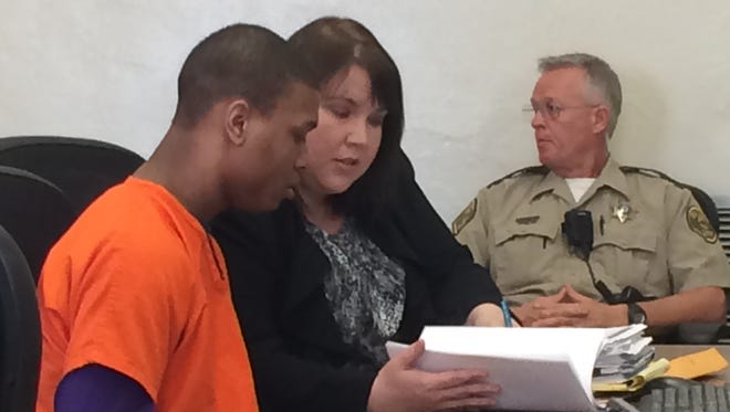 Leshaun Murray and his court-appointed attorney in court on Tuesday morning.