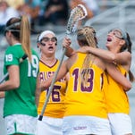 Members of the Salisbury women's lacrosse team celebrate a goal against York College on Saturday afternoon in the Capital Athletic Conference Championship.