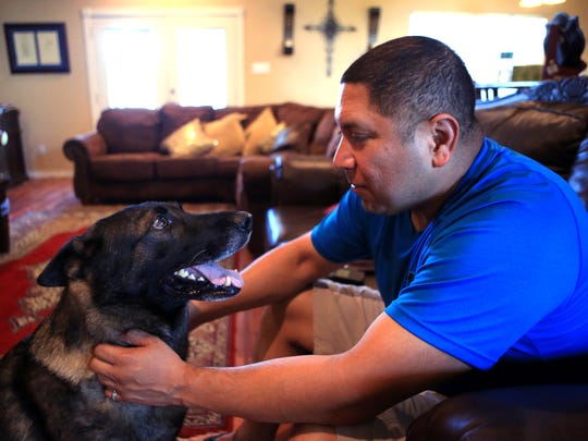 Hope sits by Le Roy Torres' side as he uses a TENS unit to help with the neuropathy in his feet and legs at his home in Robstown on Monday, March 20, 2017. Hope is his service dog and has not only helped him battle depression, but has also helped when he has had falls.