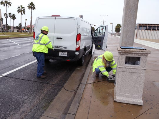 Employees with the city's road department put down vehicle counters on old Shoreline Boulevard on December 15, 2017 near the Art Center of Corpus Christi. That portion of Shoreline will be open through the holidays so officials in the city manager's office can see how much vehicular traffic goes through, said Mayor Joe McComb.