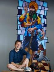 Rochester artist Allen Firlit seen here in front of