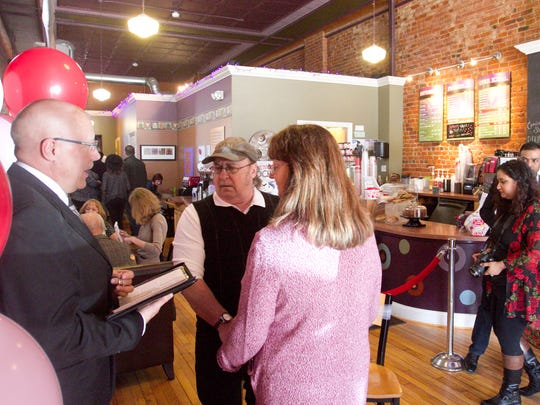Chuck Whittaker and Bonnie Crosby-Whittaker of Brighton were among those married by Howell firefighter and wedding officiant Bill Fenton at downtown Howell's Uptown Coffeehouse on Valentine's Day.