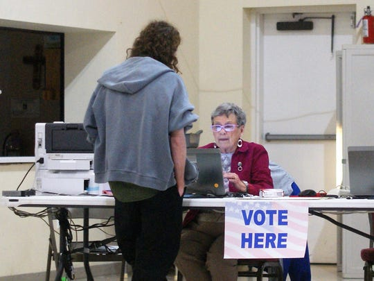 In the evening, the Holy Parish Family Hall's polling location had a line after a slow day.