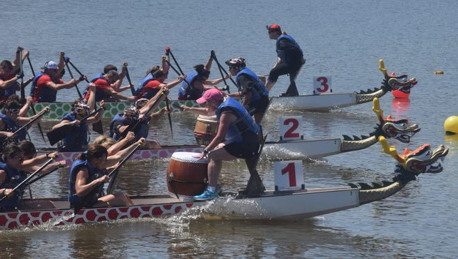 """The dragon boat team from Roy O Martin (boat 3, top) came in first with a time of 58.8 seconds in one of the Louisiana Dragon Boat Races heats held Saturday at Buhow Lake in Pineville. The dragon boat team, """"We're Sexy and We Row It"""", came in second with a time of 58.29 seconds  and the Louisiana Athletic Club came in third with a time of 58.40 seconds."""
