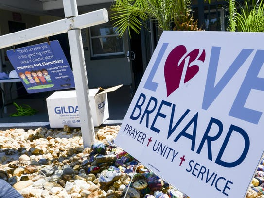 Members of Love Brevard help fix up University Park