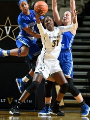 Vanderbilt forward/center Blessing Ejiofor (31) battles
