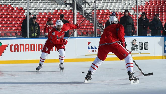Dec 30, 2016; Toronto, ON, Canada; Red Wings captain Henrik Zetterberg, left, shoots as he practices two days before playing against the Maple Leafs in the Centennial Classic at BMO Field.