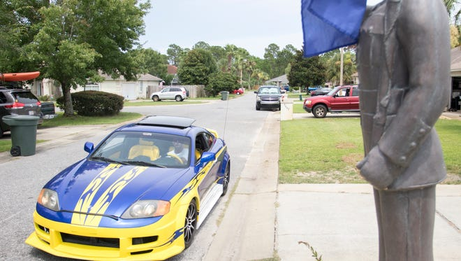 Blue Angels Super Fan Adam Canevari approaches his house while driving his Blue Angels themed painted car in Pensacola, FL on Wednesday, July 6, 2016.