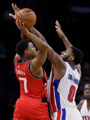 Raptors guard Kyle Lowry shoots over Pistons center Andre Drummond.