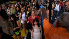 Fans pile up at the security checkpoint before a Taylor