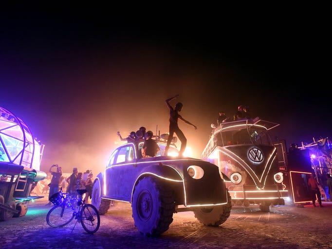 Burning Man 2017. A man dances on top of an art car
